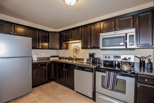 Photo of a beautiful kitchen with all new appliances in an apartment for rent.